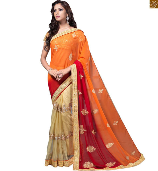 STYLISH BAZAAR PRESENTS ECSTATIC TRIUNE COLOURS OF RED ORANGE AND CREAM IN THE SAREE COMPLEMENTED WITH CREAM BLOUSE RTMAG15