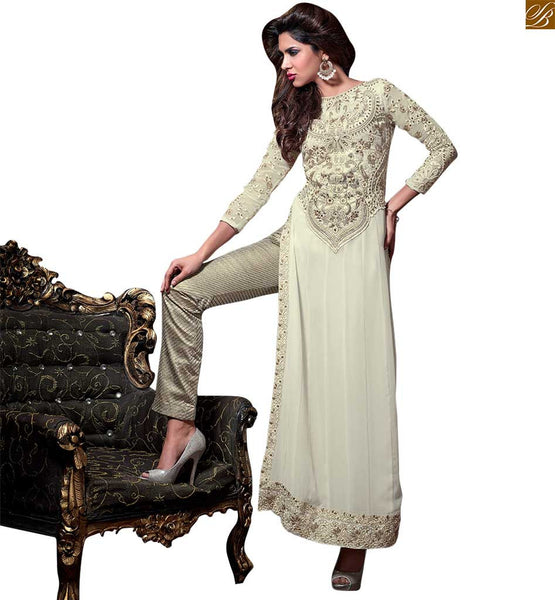 Maisha straight cut heavy embroidered neck salwaar kameez off-white georgette heavy embroidered and stone worked patch work on salwar kameez looking angle girl. Boat type neck is amazing design Image