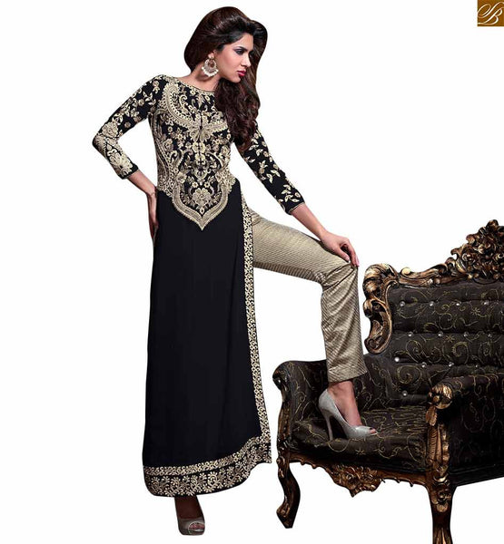 Designer salwaar kameez in straight cut with heavy embroidery black georgette three forth type floral embroidered sleeves salwar kameez. Off-white colour embroidered patch on dress with stone work Image