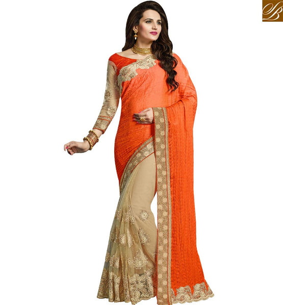 STYLISH BAZAAR INVITING ORANGE AND BEIGE CRUSE NET SAREE HAVING WELL EMBROIDERY WITH MOTI LACE WORK VDRUD17465