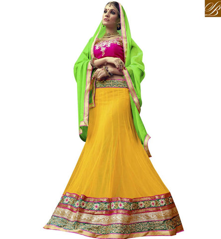 STYLISH BAZAAR ATTRACTIVE YELLOW AND PINK NET DESIGNER LEHENGA CHOLI ATTIRE WITH LACE BORDER WORK VDSNG17841