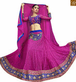 FROM THE HOUSE OF STYLISH BAZAAR INVITING PINK NET DESIGNER LEHENGA CHOLI WITH BLUE EMBROIDERED VELVET CHOLI VDSNG17842