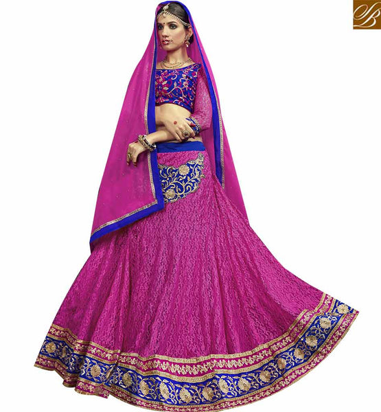 STYLISH BAZAAR INVITING PINK NET DESIGNER LEHENGA CHOLI WITH BLUE EMBROIDERED VELVET CHOLI VDSNG17842