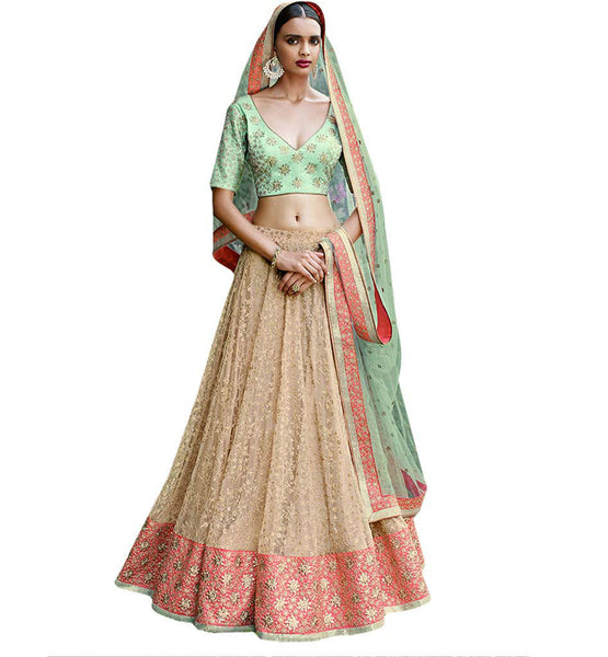 STYLISH BAZAAR SPLENDID DESIGNER GREEN CHOLI ACCOMPANIED WITH A BEIGE COLORED LEHENGA MKGR5055
