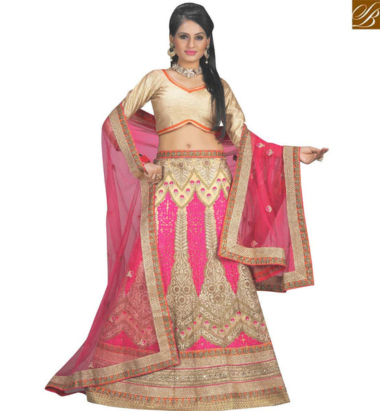 STYLISH BAZAAR STUNNING PINK NET DESIGNER LEHENGA CHOLI HAVING BEIGE AND PINK RESHAM EMBROIDERY WORK VDAVT18086
