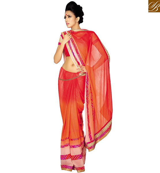 STYLISH BAZAAR DAZZLING ORANGE GEORGETTE PRINTED DESIGNER SAREE ATTIRE ATTRACTIVE PATTERN ON BOTTOM OF THE SAREE VDETF18110