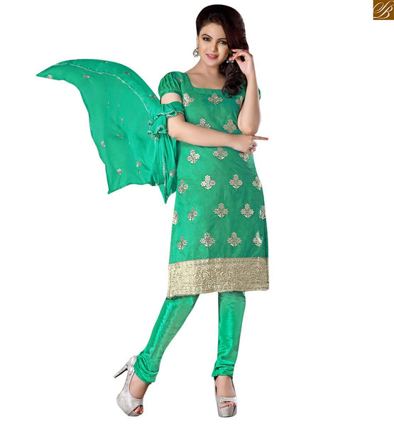 Punjabi suit boutique type trendy salwar kameez pattern dress green cotton zari embroidered salwar kameez with border line on lower and matching churidar bottom Image