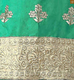 Green cotton zari embroidered salwar kameez with border line on lower and matching churidar bottom pic