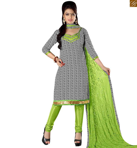 Latest punjabi suits design salwar kameez boutique type dress black cotton printed weaving salwar kameez with lace border on lower part and green churidar bottom Image