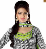 Black cotton printed latest punjabi suits design with elegnt green chiffon dupatta. This salwar kameez boutique type dress can be made to a plus size black cotton printed weaving salwar kameez with lace border on lower part and green churidar bottom photo
