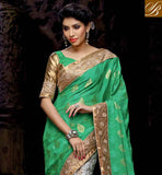 EYE CATCHING GREEN AND OFF WHITE NET VISCOSE SARI WITH GREEN AND CHIKOO LOVELY ART SILK BLOUSE IN NEW COLLECTION AMAZING ZARI WORK IN SARI WITH RESHAM DESIGNING EMBROIDERY WORK FOR ONLY FESTIVAL SARI AND ALSO LACE BORDER WITH STONE WORK