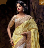 COOL YELLOW AND OFF WHITE NET VISCOSE SAREE WITH OFF WHITE AND CHIKOO LOVELY ART SILK BLOUSE NEW TIP TOP RESHAM EMBROIDERY DESIGNING WORK WITH EMBROIDERY DESIGNING BUTTA, ALSO PARI WORK, STONE WORK AND LACE BORDER