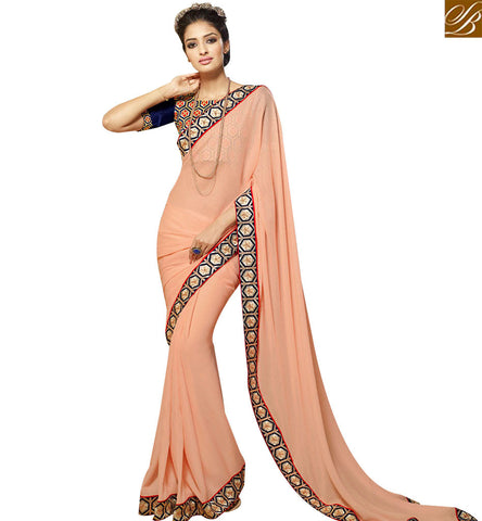 STYLISH BAZAAR CAPTIVATING PEACH SILK DESIGNER SAREE ATTIRE BLUE LACE BORDER AND BLUE EMBROIDERED BLOUSE SLHAW206