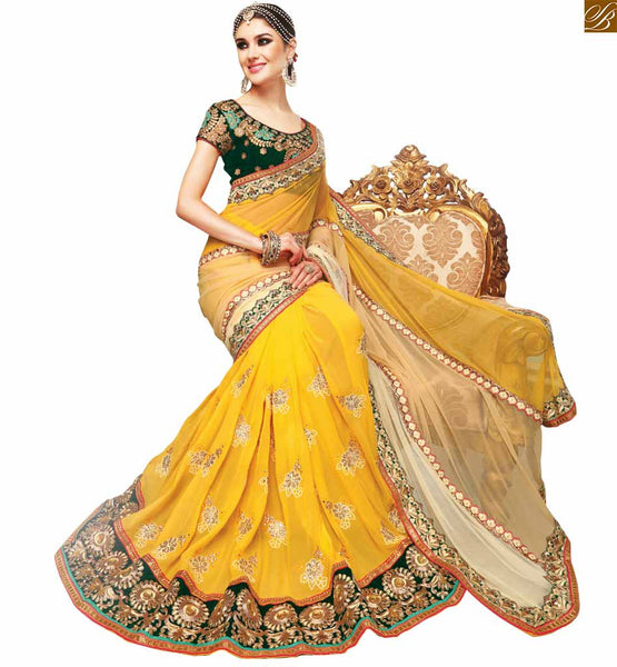 STYLISH BAZAAR INTRODUCES MARVELOUS YELLOW EMBROIDERED SARI COMBINED WITH A GREEN BLOUSE RTSAK2092