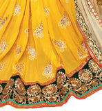 FROM STYLISH BAZAAR MARVELOUS YELLOW EMBROIDERED SARI COMBINED WITH A GREEN BLOUSE RTSAK2092