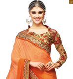 FROM STYLISH BAZAAR RADIANT ORANGE BLOUSE MATCHED WITH CREAM EMBROIDERED SARI RTSAK2094