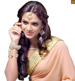STYLISH BAZAAR INTRODUCES ELEGANT PEACH AND CREAM SAREE SUPPLEMENTED WITH A CREAM BLOUSE RTMAG21