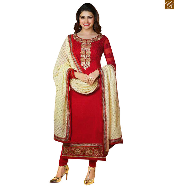 Red designer dress made of georgette with floral embroidery work at neck line in kameez with matching bottom. Also contains embroidered border at the lower part iMAGE
