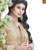 A STYLISH BAZAAR PRESENTATION MODISH CREAM COLORED DESIGNER SUIT WITH GLITTERY EMBROIDERY WORK SLNZK30004