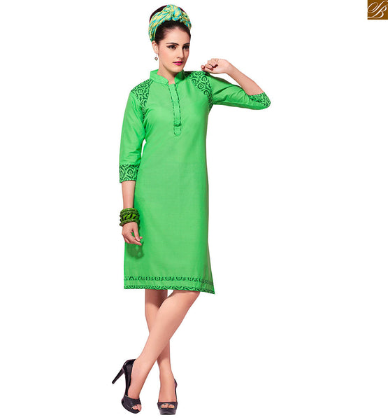 Kurti designs stylish cotton tops for girls fashion and style green pure-cotton floral printed kurti and three fourth style printed sleeve with border line Image