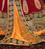 Meroon Velvet lehenga with motiwork and yellow dupatta