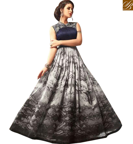 STYLISH BAZAAR PLEASING GREY SILK DESIGNER SUIT WITH GOWN STYLE AND BLACK FLARAL PRINT SLMSH3406