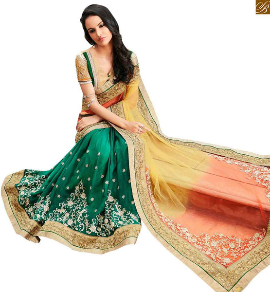STYLISH BAZAAR DESIGNER GREEN EMBROIDERED SAREE MATCHED WITH A CREAM BLOUSE ANOB35