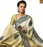 FROM STYLISH BAZAAR BEAUTIFUL CREAM AND GOLD SATIN SILK SAREE HAVING JARI BORDER AND HEAVY DIAMOND WORK SLMN3501A