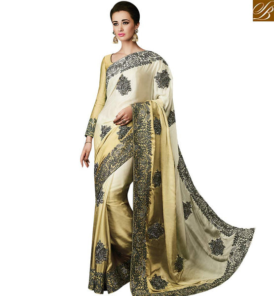 STYLISH BAZAAR BEAUTIFUL CREAM AND GOLD SATIN SILK SAREE HAVING JARI BORDER AND HEAVY DIAMOND WORK SLMN3501A