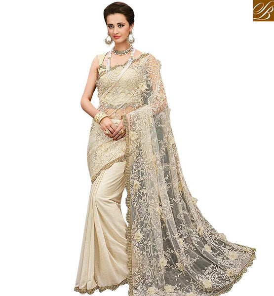 STYLISH BAZAAR AMAZING CREAM LYCRA DESIGNER SAREE ATTIRE PALLU WITH GORGEOUS GLIMPSE OF EMBROIDERY SLMN3504A
