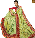FROM STYLISH BAZAAR INVITING PISTA GREEN SILK DESIGNER SAREE ATTIRE KOLKATA LACE BORDER WORK WITH RED WORKED BLOUSE SLMN3507