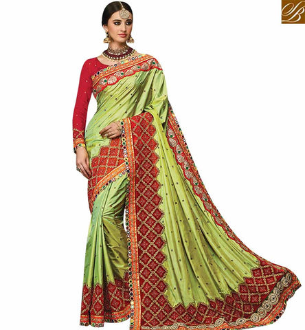STYLISH BAZAAR INVITING PISTA GREEN SILK DESIGNER SAREE ATTIRE KOLKATA LACE BORDER WORK WITH RED WORKED BLOUSE SLMN3507
