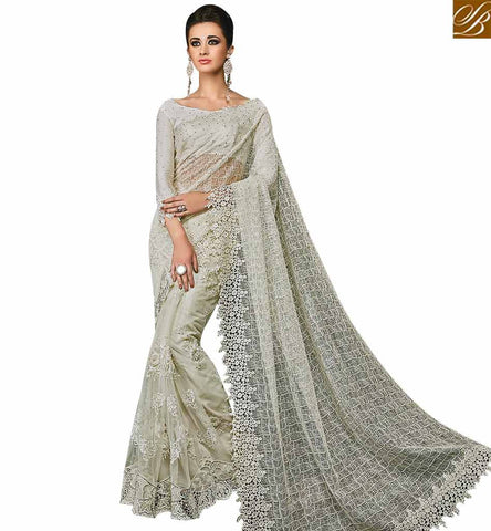STYLISH BAZAAR PLEASING CREAM NET DESIGNER SAREE ATTIRE FASHIONABLE EMBROIDERED PALLU WITH PLEASANT GLANCE SLMN3508