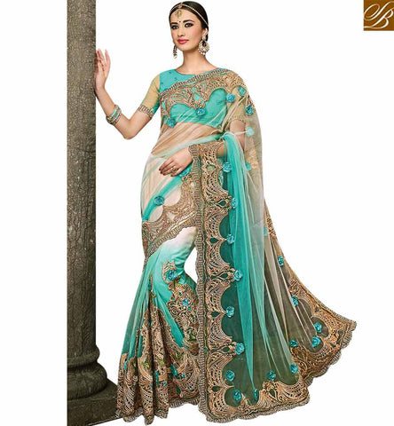STYLISH BAZAAR DAZZLING SKY BLUE NET HEAVY EMBEDDED SAREE HAVING ENCHANTING GLIMPSE OF THE ERA SLMN3510A
