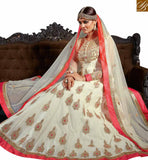 BLOOMING CREAM ART SILK DESIGNER ANARKALI SALWAR KAMEEZ WITH HEAVY EMBROIDERY AND MOTI WORK SLVSM3585
