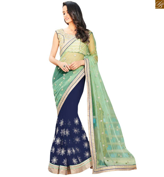 STYLISH BAZAAR BLUE AND GREEN COLOURED SPECTACULAR PARTY WEAR SARI COMPLEMENTED WITH A CREAM BLOUSE ANOB36