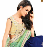 FROM STYLISH BAZAAR BLUE AND GREEN COLOURED SPECTACULAR PARTY WEAR SARI COMPLEMENTED WITH A CREAM BLOUSE ANOB36