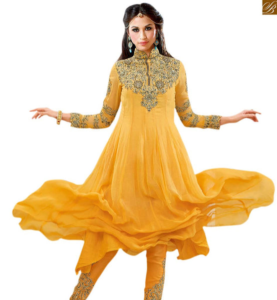New salwar kameez designs indian traditional dresses collection yellow georgette heavy resham embroidered salwar kameez and matching heavy embroidery work on bottom Image