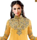 Captivate the on lookers with this new salwar kameez designs from our exciting new indian traditional dresses collection yellow georgette heavy resham embroidered salwar kameez and matching heavy embroidery work on bottom Photo