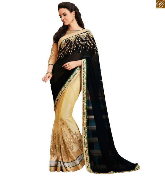 STYLISH BAZAAR RAVISHING BLACK AND CREAM COLORED EMBROIDERED SARI TEAMED UP WITH A CREAM BLOUSE ANOB39
