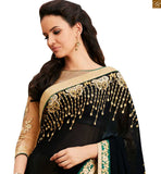 STYLISHBAZAAR RAVISHING BLACK AND CREAM COLORED EMBROIDERED SARI TEAMED UP WITH A CREAM BLOUSE ANOB39