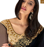 A STYLISH BAZAAR PRESENTATION STRIKING BLACK COLORED SAREE WITH GLITTERING BORDER WORK NKITA4048