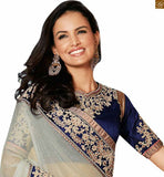STYLISHBAZAAR ATTRACTIVE WHITE AND PEACH DESIGNER SAREE WITH A BLUE BLOUSE ANOB43