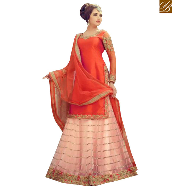 STYLISH BAZAAR WONDERFUL ORANGE SILK DESIGNER SUIT WITH PEACH COLOUR NET LEHENGA HAVING LACE BORDER WORK MNJ29004