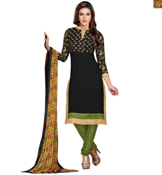 Straight cut long salwar kameez beautiful dresses at cheap rate black cotton floral embroidered salwar kameez with lace border with green cotton churidar bottom Image