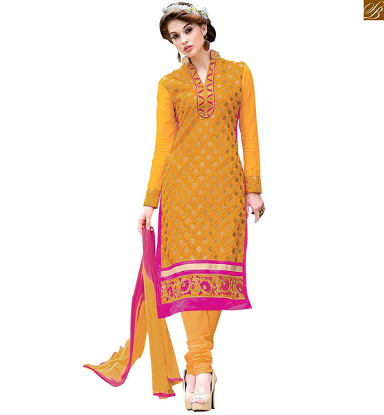 Pakistani designer salwar kameez for stylish ladies suits set yellow chanderi floral embroidered salwar kameez with border work and yellow santoon churidar bottom Image