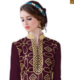 Latest salwar designs having geometrical figures on long kameez. A casual style suit for stitching to be used for daily wear brown chanderi high neck designer salwar kameez with patch work and beige santoon cuted bottom Photo