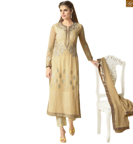 Indian traditional dresses salwar kameez design 2015 trend peach georgette heavy embroidered neck line design salwar kameez with matching brocket bottom Photo