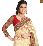 FROM STYLISH BAZAAR GRACEFUL CREAM SARI CONJUGATED WITH A RED BLOUSE RTHTS5015