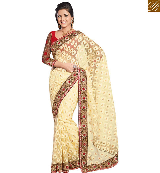 FROM THE HOUSE  OF STYLISH BAZAAR GRACEFUL CREAM SARI CONJUGATED WITH A RED BLOUSE RTHTS5015